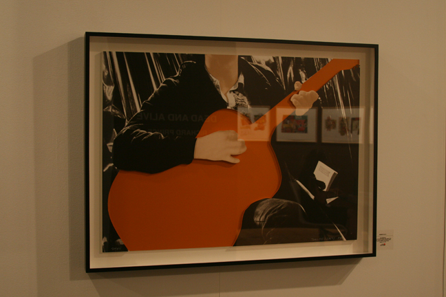 art-basel-2008-john-baldessari-person-with-guitar-orange-gemini1