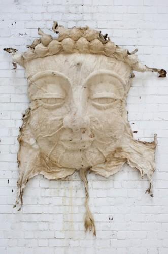 an analysis of cowskin buddha face by artist zhang huan