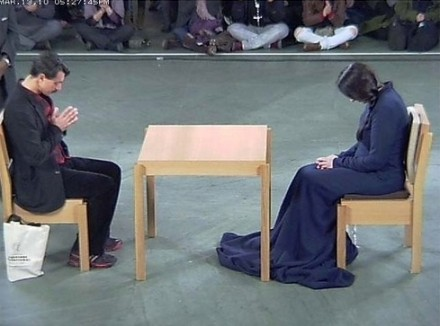 Marina Abramovic in performance at MoMA, via Art Observed
