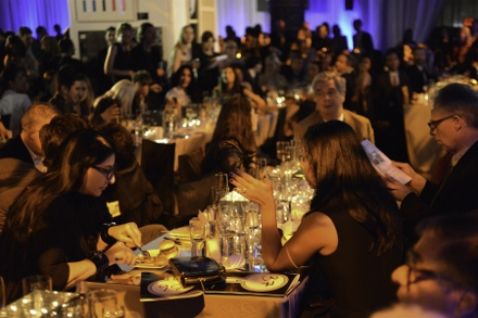 Marina Abramović dining with other guests