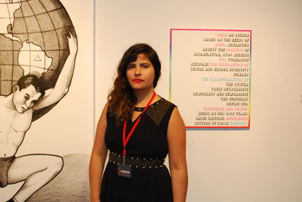 Gallerist Cecilia Jurado of Y Gallery, NY in front of two works by Carlos Motta