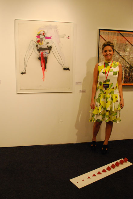 Gallery assistant Clarissa Lima in front of two Rodrigo Tizil Lima pieces. Huma Art Projects, Rio de Janeiro.