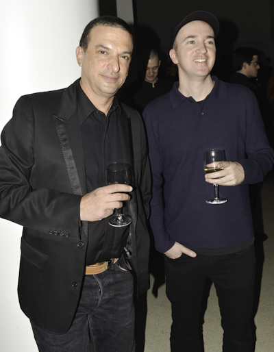 Guest and artist KAWS (right)