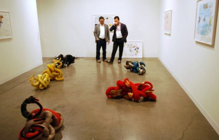 Andrew Kreps Gallery, ABMB. Gallerist Andrew Kreps looking at Christian Holstad, Ouroboros series (2012)
