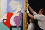 Workers at Sotheby's, via Reuters