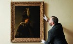 Buckland Abbey Curator David Taylor with the newly rediscovered Rembrandt, via the Guardian