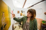 A student works on her art in a converted studio space at Pratt Institute, via New York Times