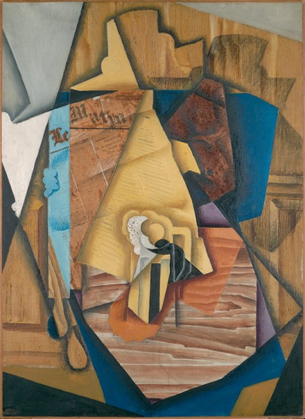 Juan Gris, Figure Seated in a Café (Man at a Table) (1914). via New York Times