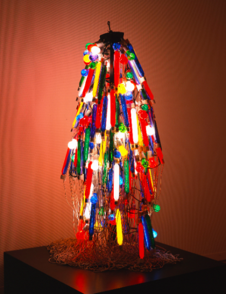 Tanaka Atsuko, Electric Dress (1956), (refabricated 1986).  Synthetic paint on incandescent lightbulbs, electric cords, and control console, approximately 165 × 80 × 80 cm  Takamatsu City Museum of Art, Japan © Itō Ryōji, courtesy Takamatsu City Museum of Art