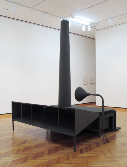 Mark Manders, Room With Reduced Chair And Camouflaged Factory (2003), via MoMAPS1