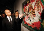 Saif Al-Islam Gaddafi showing off art, via Art Newspaper