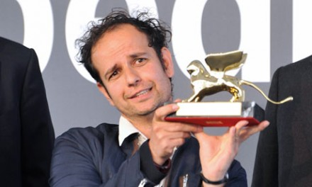 Tino Sehgal displays his Golden Lion award for best artist at the Venice Biennale, via The Guardian