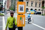 Bundith Phunsombatlert with one of his signs, via Wall Street Journal