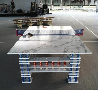 A ping pong table at Night Court, via Daniel Creahan for Art Observed