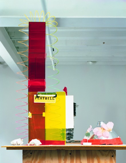 Isa Genzken. Fuck the Bauhaus #4, 2000. Plywood, Plexiglas, plastic slinky, clipboards, aluminum light shade, flower petals, tape, printed paper, shells, and model tree. 88 3/16 x 30 5/16 x 24″ (224 x 77 x 61 cm). Private Collection, Turin. Courtesy AC Project Room, New York. © Isa Genzken