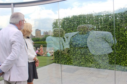Visitors looking at their reflections in Hedge Two-Way Mirror Walkabout