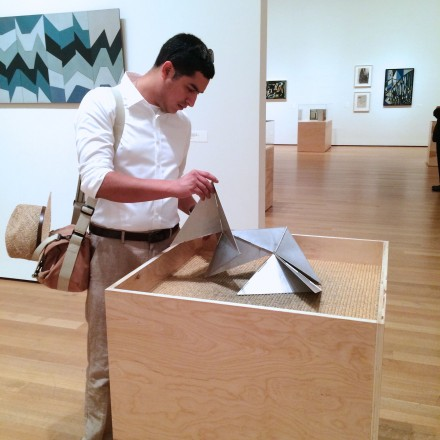 Visitor-playing-with-Bichos-replica-in-Lygia-Clark-Retrospective-at-MoMA