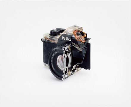 Christopher Williams, Cutaway model Nikon EM. Shutter:/Electronically governed Seiko metal blade shutter vertical travel with speeds from 1/1000 to 1 second with a manual speed of 1/90th./Meter: Center-weighted Silicon Photo Diode, ASA 25-1600/EV2-18 (with ASA film and 1.8 lens)/Aperture Priority automatic exposure/Lens Mount: Nikon F mount, AI coupling (and later) only/Flash: Synchronization at 1/90 via hot shoe/Flash automation with Nikon SB-E or SB-10 flash units/Focusing: K type focusing screen, not user interchangeable, with 3mm diagonal split image rangefinder/Batteries: Two PX-76 or equivalent/Dimensions: 5.3 × 3.38 × 2.13 in. (135 × 86 × 54 mm), 16.2 oz (460g)/Photography by the Douglas M. Parker Studio, Glendale, California/September 9, 2007– September 13, 2007. via The Museum of Modern Art, 2014.