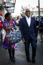 Glenn Ligon and Thelma Golden with Ligon's specially designed bag, via WSJ