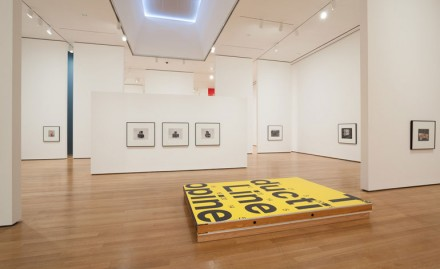 Installation view of Christopher Williams The Production Line of Happiness via The Museum of Modern Art, 2014.