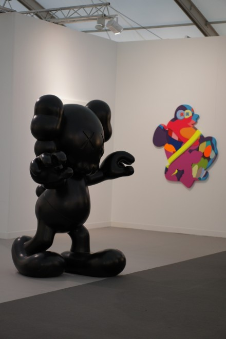 A pair of KAWS works on view at Perrotin, via Andrea Nguyen for Art