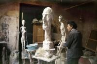 Giacometti in his studio, via NYT