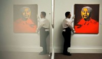 A handler installs an Andy Warhol, via Fortune