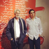 Chris Dercon and artist Ashram Fayadh, via Artforum
